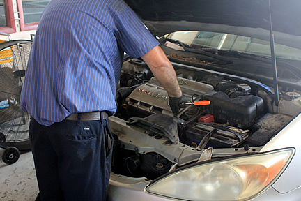 auto repair, transmission, clutch repair, air conditioning service, brakes, tires, exhaust systems